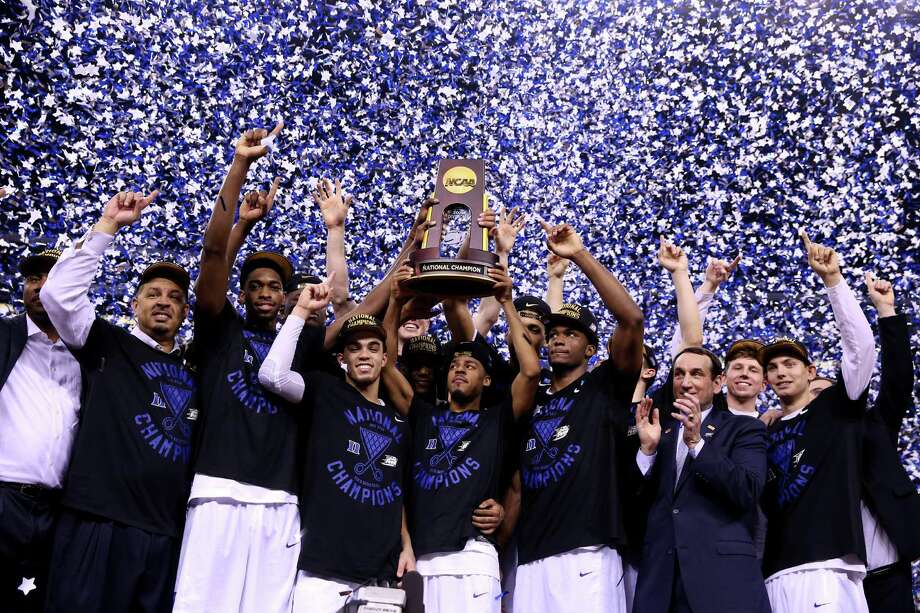 INDIANAPOLIS, IN - APRIL 06:  The Duke Blue Devils celebrate with the championship trophy after defeating the Wisconsin Badgers during the NCAA Men's Final Four National Championship at Lucas Oil Stadium on April 6, 2015 in Indianapolis, Indiana. Duke defeated Wisconsin 68-63.  (Photo by Streeter Lecka/Getty Images) ORG XMIT: 527066925 Photo: Streeter Lecka / 2015 Getty Images