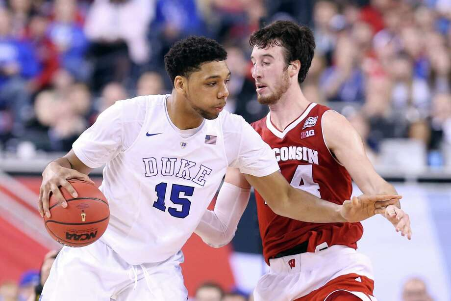 Duke's Jahlil Okafor handles the ball against Wisconsin's Frank Kaminsky in the second half. Photo: Streeter Lecka /Getty Images / 2015 Getty Images