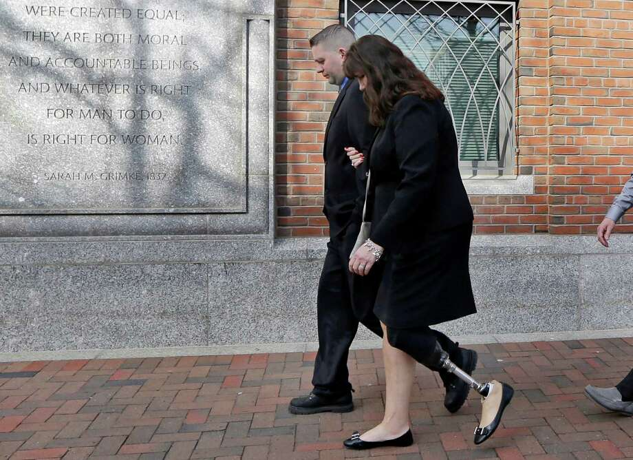 Boston Marathon bombing survivor Karen Rand walks from federal court in Boston after closing arguments in the trial of Dzhokhar Tsarnaev, who could face the death penalty. Photo: Elise Amendola /Associated Press / AP