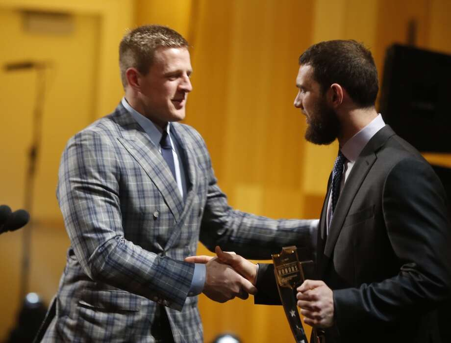 J.J. Watt, of the Houston Texans, accepts the AP defensive player of the year award, left, and Andrew Luck of the Indianapolis Colts, on stage at the 4th annual NFL Honors at the Phoenix Convention Center Symphony Hall on Saturday, Jan. 1, 2015. (Photo by Colin Young-Wolff/Invision for NFL/AP Images) Photo: Colin Young-Wolff/Invision/AP
