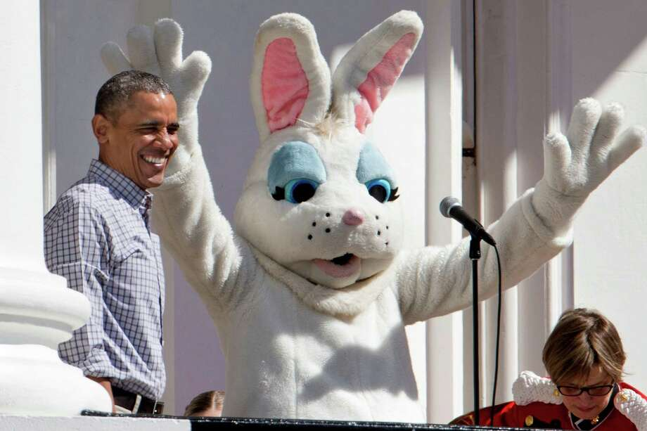 President Barack Obama smile next to the Easter Bunny during the White House Easter Egg Roll on the South Lawn of White House in Washington, Monday, April 6, 2015. Thousands of children gathered at the White House for the annual Easter Egg Roll. This year's event features live music, cooking stations, storytelling, and of course, some Easter egg roll.  Photo: Jacquelyn Martin, Associated Press / AP