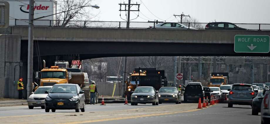 New York State Department of Transportation and Town of Colonie Water Department trucks queue up for a repair of a broken water main under the I-87 overpass on Central Avenue Monday morning April 6, 2015 in Colonie, N.Y.   (Skip Dickstein/Times Union) Photo: SKIP DICKSTEIN / 00031315A