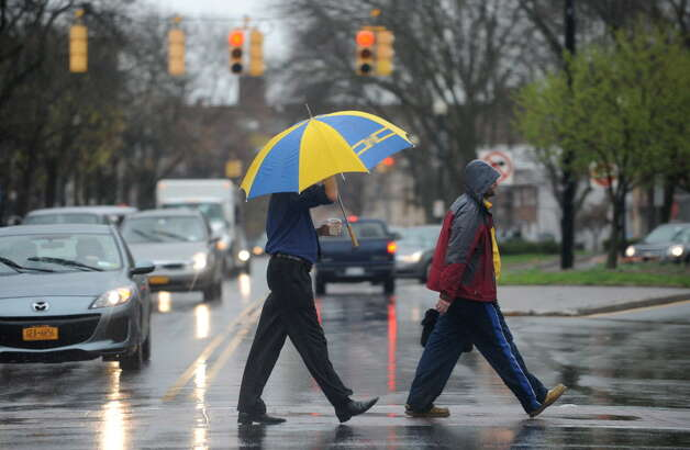 Pedestrians cross Central Ave. near Lark St. in the rain Wednesday, April 30, 2014 in Albany, N.Y  (Lori Van Buren / Times Union archive) ORG XMIT: MER2014050512143203 Photo: Lori Van Buren