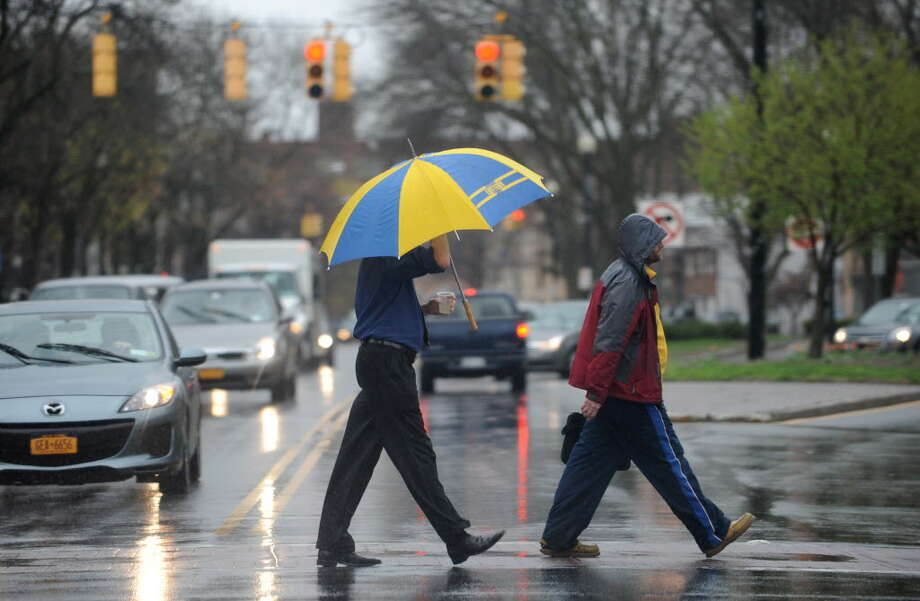 Pedestrians cross Central Ave. near Lark St. in the rain Wednesday, April 30, 2014 in Albany, N.Y  (Lori Van Buren / Times Union archive) ORG XMIT: MER2014050512143203 Photo: Lori Van Buren