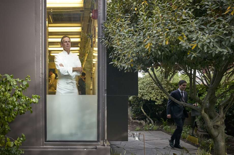 Thomas Keller looking toward the dining room  on Saturday evening in  the temporary kitchen Photo: Deborah Jones