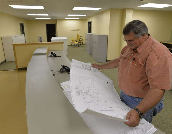Doug VanDeusen of Lamont Engineering looks over the plans for the renovation of the Schoharie County office building Tuesday June 18, 2013, in Schoharie, N.Y.  As construction and renovation continues on the building County offices are repopulating for the first time since super storm Irene.   Lamont Engineering is the project coordinator for the renovation of the Schoharie County Office Building.     (Skip Dickstein/Times Union archive) Photo: SKIP DICKSTEIN / 10022859A