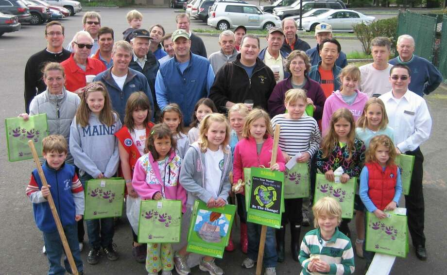 The Darien Beautification Commission and the Darien Chamber of Commerce will sponsor the annual Darien Spring Clean Up on April 24. Above are volunteers from last year's clean up. Photo: Contributed Photo / Darien News