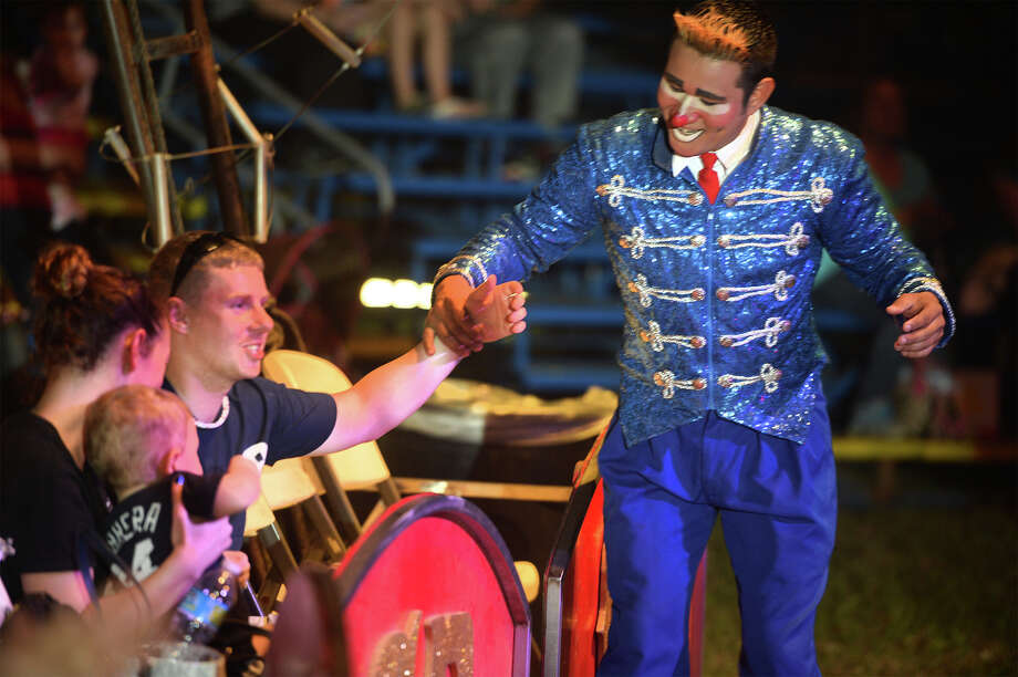 A clown enlists Brandon Purser from the audience during the Circus in Kountze on Monday. Photo taken Monday, April, 06, 2015 Guiseppe Barranco/The Enterprise Photo: Guiseppe Barranco, Photo Editor