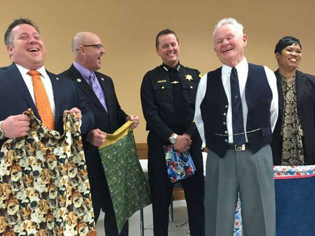 Albany County Executive Dan McCoy, left; Sheriff Craig Apple, third from right; and Village Mayor Jim Gaughan, second from right, gather with the Train Station Quilters and children's aid groups on Tuesday, April 7, 2015, in Altamont Village Hall. (Cindy Schultz/Times Union)