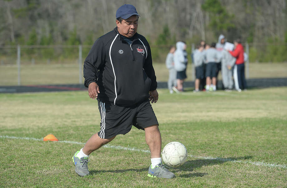 Head coach Jorge Hernandez offers instruction as the team runs drills during Thursday's practice. Sisters Kathryne (left) and Raegan Padgett are a driving force on the Hardin-Jefferson varsity soccer team, which is currently undefeated and eyeing a spot in the play-offs.  Photo taken Thursday, February 26, 2015  Kim Brent/The Enterprise Photo: Kim Brent / Beaumont Enterprise