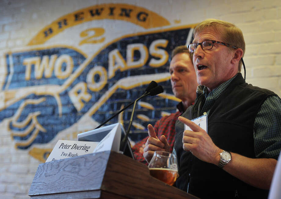 Peter Doering, left, and Brad Hittle, of Two Roads Brewing Company, address the Association for Corporate Growth/Crossroads Venture Group Northeast Consumer Products conference at the brewery in Stratford, Conn. on Monday, April 6, 2015. Photo: Brian A. Pounds / Connecticut Post