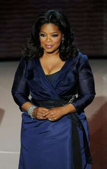 HOLLYWOOD - MARCH 07:  Oprah Winfrey presents onstage during the 82nd Annual Academy Awards held at Kodak Theatre on March 7, 2010 in Hollywood, California.  (Photo by Kevin Winter/Getty Images) *** Local Caption *** Oprah Winfrey Photo: Kevin Winter, Getty Images / 2010 Getty Images