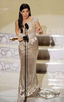 """HOLLYWOOD - MARCH 07:  Actress Sandra Bullock accepts Best Actress award for """"The Blind Side"""" onstage during the 82nd Annual Academy Awards held at Kodak Theatre on March 7, 2010 in Hollywood, California.  (Photo by Kevin Winter/Getty Images) *** Local Caption *** Sandra Bullock Photo: Kevin Winter, Getty Images / 2010 Getty Images"""