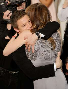 """HOLLYWOOD - MARCH 07:  Actor Jeremy Renner embraces director Kathryn Bigelow, winner of Best Director award for """"The Hurt Locker,"""" onstage during the 82nd Annual Academy Awards held at Kodak Theatre on March 7, 2010 in Hollywood, California.  (Photo by Kevin Winter/Getty Images) *** Local Caption *** Jeremy Renner;Kathryn Bigelow Photo: Kevin Winter, Getty Images / 2010 Getty Images"""