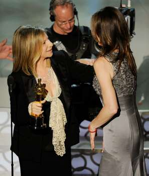 """HOLLYWOOD - MARCH 07:  Director Kathryn Bigelow (R) accepts Best Director award for """"The Hurt Locker"""" from presenter Barbra Streisand onstage during the 82nd Annual Academy Awards held at Kodak Theatre on March 7, 2010 in Hollywood, California.  (Photo by Kevin Winter/Getty Images) *** Local Caption *** Barbra Streisand;Kathryn Bigelow Photo: Kevin Winter, Getty Images / 2010 Getty Images"""