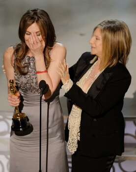 """HOLLYWOOD - MARCH 07:  Director Kathryn Bigelow (L) accepts Best Director award for """"The Hurt Locker"""" from presenter Barbra Streisand onstage during the 82nd Annual Academy Awards held at Kodak Theatre on March 7, 2010 in Hollywood, California.  (Photo by Kevin Winter/Getty Images) *** Local Caption *** Kathryn Bigelow;Barbra Streisand Photo: Kevin Winter, Getty Images / 2010 Getty Images"""