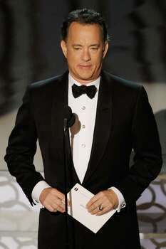 HOLLYWOOD - MARCH 07:  Actor Tom Hanks presents the award for 'Best Picture' onstage during the 82nd Annual Academy Awards held at Kodak Theatre on March 7, 2010 in Hollywood, California.  (Photo by Kevin Winter/Getty Images) *** Local Caption *** Tom Hanks Photo: Kevin Winter, Getty Images / 2010 Getty Images