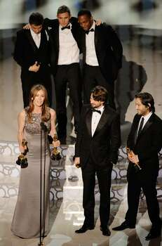 """HOLLYWOOD - MARCH 07:  (Front L-R) Director Kathryn Bigelow, screenwriter Mark Boal and producer Greg Shapiro, and (rear L-R) actors Jeremy Renner, Brian Geraghty and Anthony Mackie accept Best Picture award for """"The Hurt Locker"""" onstage during the 82nd Annual Academy Awards held at Kodak Theatre on March 7, 2010 in Hollywood, California.  (Photo by Kevin Winter/Getty Images) *** Local Caption *** Kathryn Bigelow;Mark Boal;Greg Shapiro;Jeremy Renner;Brian Geraghty;Anthony Mackie Photo: Kevin Winter, Getty Images / 2010 Getty Images"""