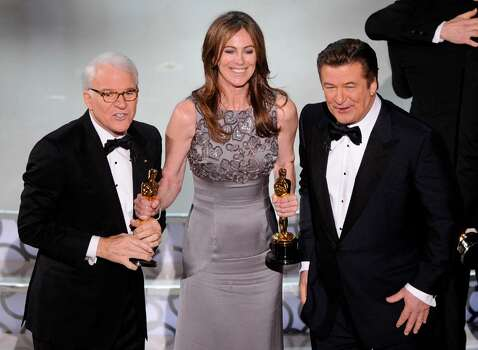 """Kathryn Bigelow, center, holds her Oscars for best motion picture of the year and best achievement in directing for """"The Hurt Locker"""" with hosts Alec Baldwin, right, and Steve Martin at the conclusion of the 82nd Academy Awards Sunday,  March 7, 2010, in the Hollywood section of Los Angeles. (AP Photo/Mark J. Terrill) Photo: Mark J. Terrill, ASSOCIATED PRESS / AP2010"""
