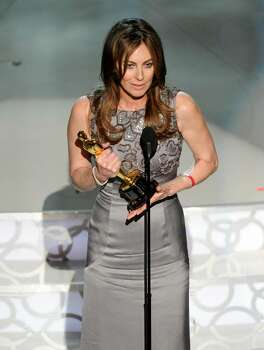 Kathryn Bigelow accepts the Oscar for best achievement in directing for ?The Hurt Locker? at the 82nd Academy Awards Sunday, March 7, 2010, in the Hollywood section of Los Angeles. (AP Photo/Mark J. Terrill) Photo: Mark J. Terrill, ASSOCIATED PRESS / AP2010