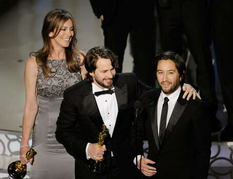 """HOLLYWOOD - MARCH 07: (Front L-R) Director Kathryn Bigelow, screenwriter Mark Boal and producer Greg Shapiro accept Best Picture award for """"The Hurt Locker"""" onstage during the 82nd Annual Academy Awards held at Kodak Theatre on March 7, 2010 in Hollywood, California.  (Photo by Kevin Winter/Getty Images) *** Local Caption *** Kathryn Bigelow;Mark Boal;Greg Shapiro Photo: Kevin Winter, Getty Images / 2010 Getty Images"""