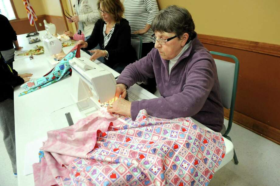 Train Station Quilters Charlene Stevens, right, and Ruth Reilly sew pillowcases for the Pillowcase Project, which benefits foster children, on Tuesday, April 7, 2015, at the Altamont Village Hall in Altamont, N.Y. (Cindy Schultz / Times Union) Photo: Cindy Schultz / 00031324A