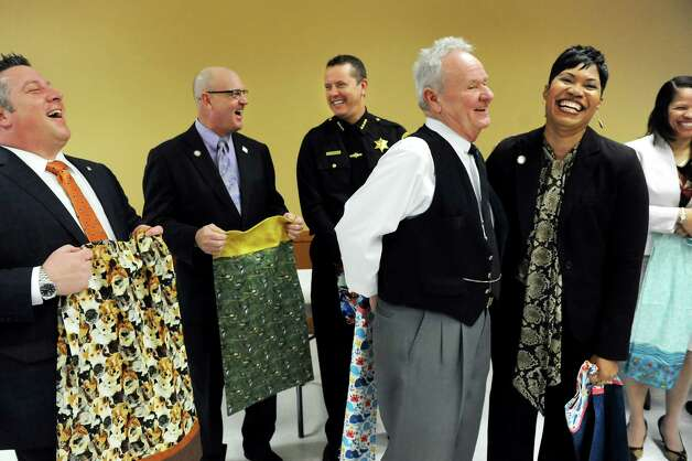 Village Mayor Jim Gaughan, center, draws a laugh as he comments on the Pillowcase Project during a news conference on Tuesday, April 7, 2015, at the Altamont Village Hall in Altamont, N.Y. Joining him, from left, are Albany County Executive Dan McCoy, Albany County Clerk Bruce Hidley, Sheriff Craig Apple, Albany County Commissioner Gail Geohagen-Pratt with the Dept. for Children, Youth and Families and Patricia DeJesus of St. Catherine's Center for Children. The Train Station Quilters of Altamont are sewing pillowcases for the project. (Cindy Schultz / Times Union) Photo: Cindy Schultz / 00031324A