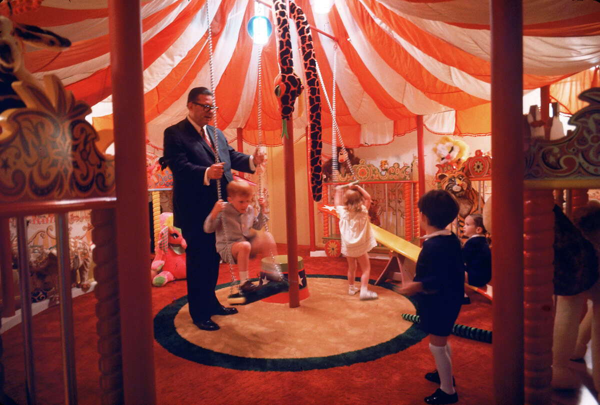 Judge Roy Hofheinz playing with his grandchildren in a private playroom at the Houston Astrodome. (Photo by Mark Kauffman/The LIFE Images Collection/Getty Images)