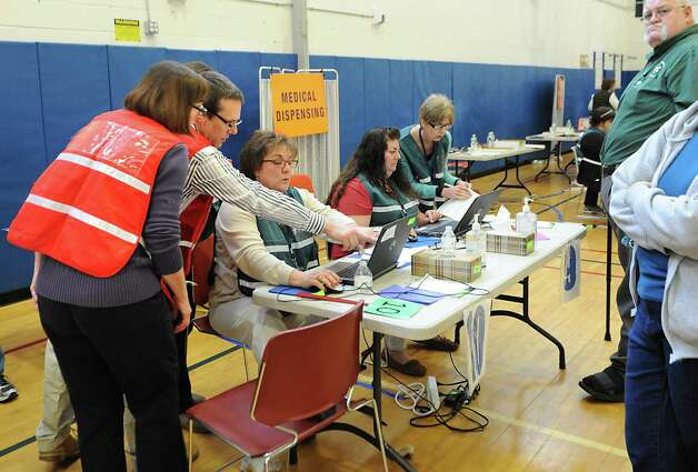 Saratoga County Public Health officials conduct a mass antibiotic dispensing exercise at Maple Avenue Middle School on Tuesday, April 7, 2015, in Saratoga Springs, N.Y. The exercise was to test the department's capacity to respond to a large-scale disease outbreak to protect the public. (Lori Van Buren / Times Union) Photo: Lori Van Buren / 00031334A