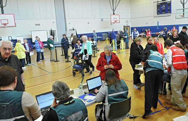 Saratoga County Public Health officials conduct a mass antibiotic dispensing exercise at Maple Avenue Middle School on Tuesday, April 7, 2015 in Saratoga Springs, N.Y. The exercise was to test the department's capacity to respond to a large scale disease outbreak to protect the public. (Lori Van Buren / Times Union) Photo: Lori Van Buren / 00031334A