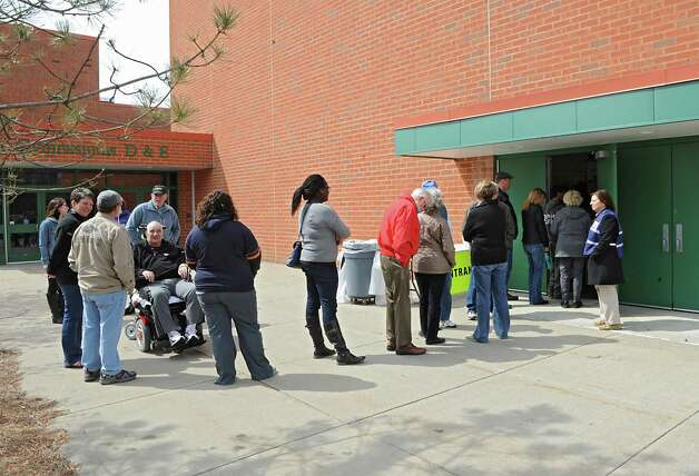 People wait in line as Saratoga County Public Health officials conduct a mass antibiotic dispensing exercise at Maple Avenue Middle School on Tuesday, April 7, 2015 in Saratoga Springs, N.Y. The exercise was to test the department's capacity to respond to a large scale disease outbreak to protect the public. (Lori Van Buren / Times Union) Photo: Lori Van Buren / 00031334A