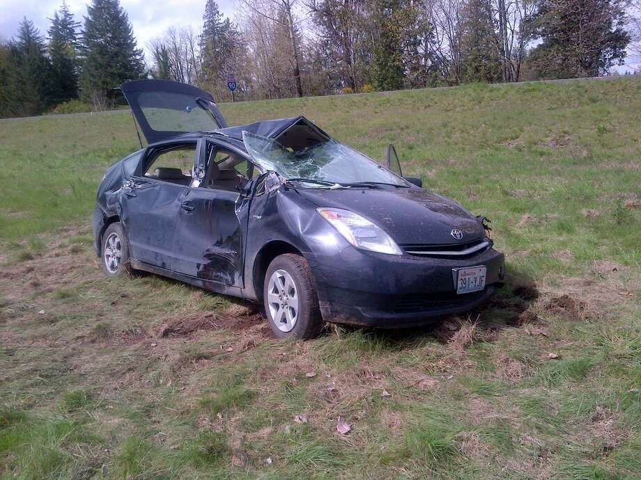The State Patrol is looking for witnesses to a North Bend hit-and-run in which a semi truck hit this Toyota Prius on Monday, injuring a passenger. Photo: Washington State Patrol