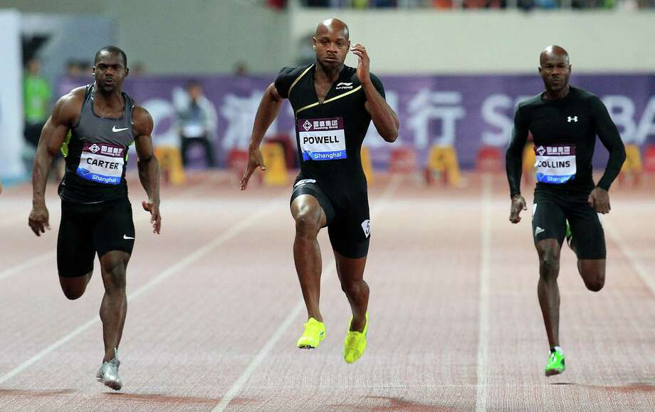 Asafa Powell of Jamaica (center) competes with Nesta Carter of Jamaica (left) and Kim Collins of Saint Kitts, right, during the men's 100 meters at the Diamond League track and field competition in Shanghai, China, in 2013. Photo: Eugene Hoshiko /Associated Press / AP