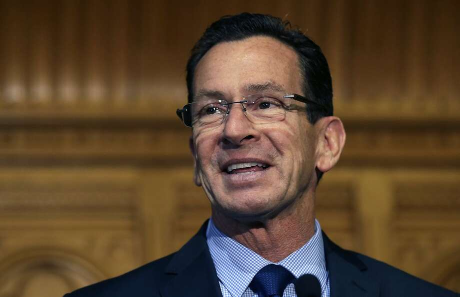 FILE - In this Nov. 5, 2014 file photo, Connecticut Gov. Dannel Malloy smiles as he thanks supporters at the State House in Hartford.   As the legislature's budget-writing committees begin the task of crafting a response Malloy's proposed budget, one of the biggest challenges they face is replenishing deep cuts in social services/health funding (mostly Medicaid) while keeping under the state's constitutional cap on spending.  (AP Photo/Charles Krupa) Photo: Charles Krupa, Associated Press