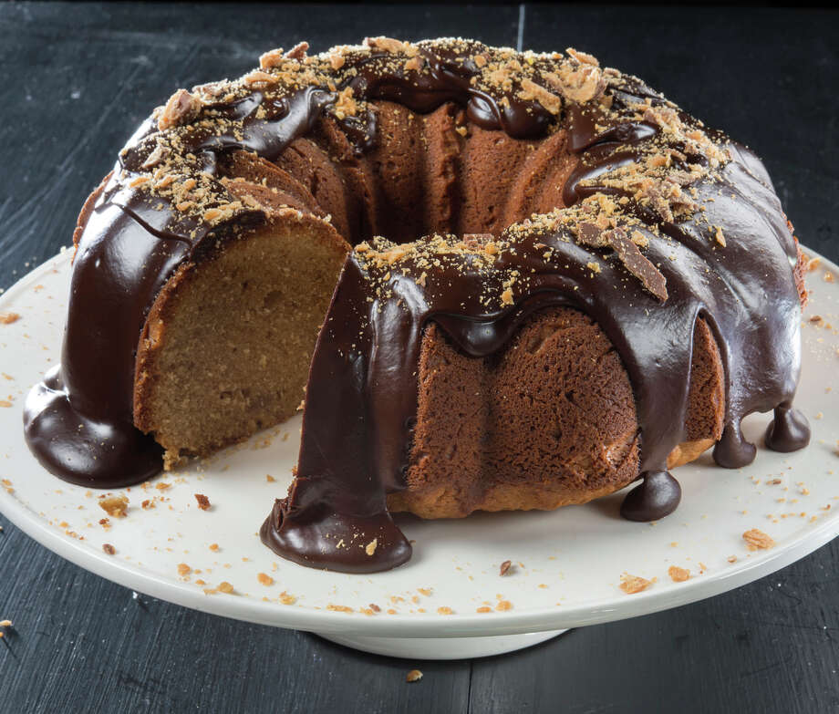 Peanut Butter-Sour Cream Bundt Cake with Butterfinger- Ganache Glaze combines everybody's favorite flavors. Photo: Tammy Ljungblad /Tribune News Service / Kansas City Star