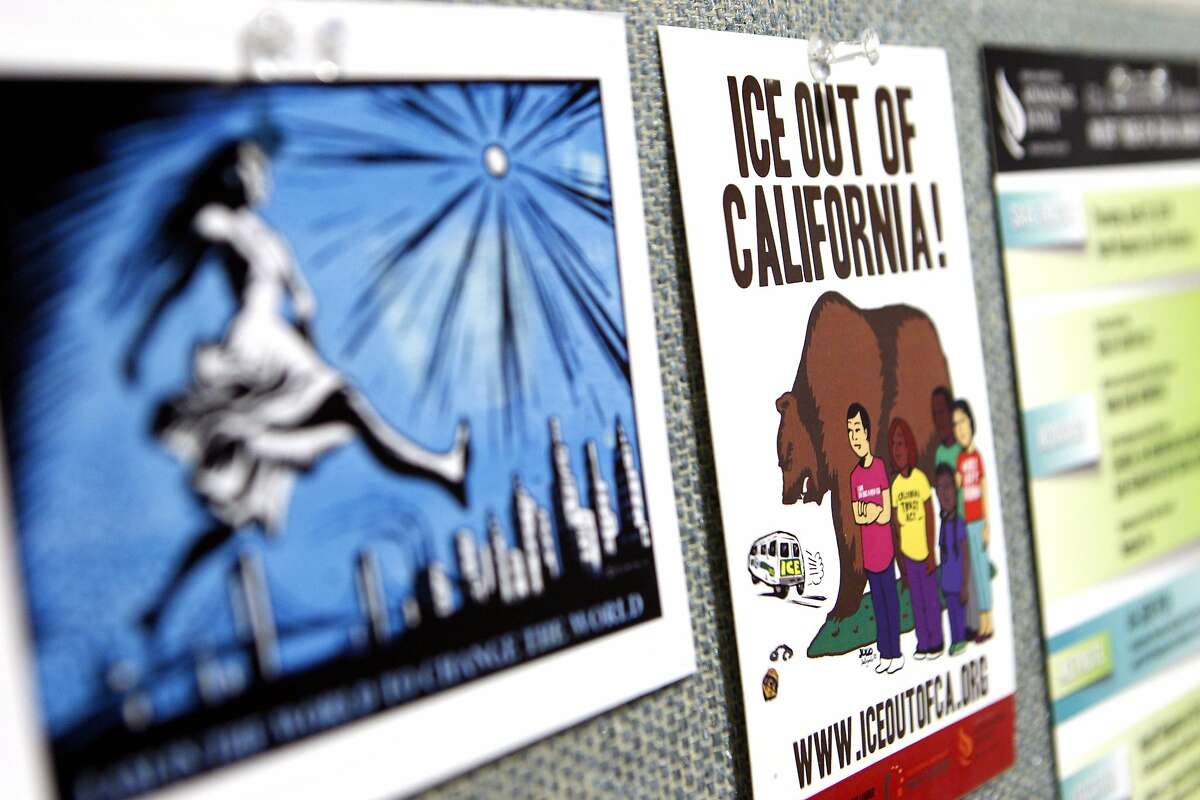 The offices at the Asian Law Caucus are covered with pro-immigration signs, Tuesday, April 7, 2015, in San Francisco, Calif.