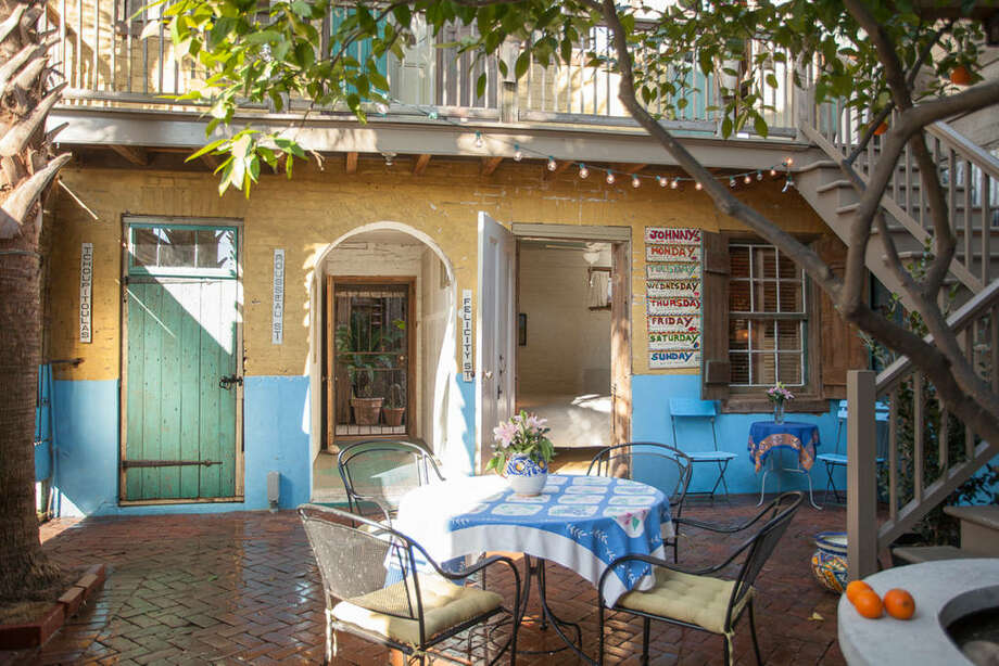 """""""Courtyard room in 1834 building"""" Price: $119  The shared courtyard is an """"outdoor living room"""" shaded by palm trees. There's also a shared bathroom, a small price to pay for an authentic stay just a 15 minute walk from Canal Street.Source: Airbnb"""