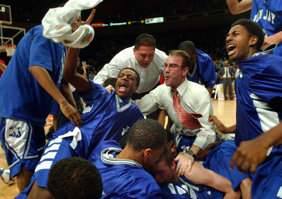Players and coaches storm the court to celebrate the Jay Mustangs' victory in the Class 5A state championship game on March 9, 2002, at the Erwin Center in Austin. Photo: Tom Reel /San Antonio Express-News / SAN ANTONIO EXPRESS-NEWS