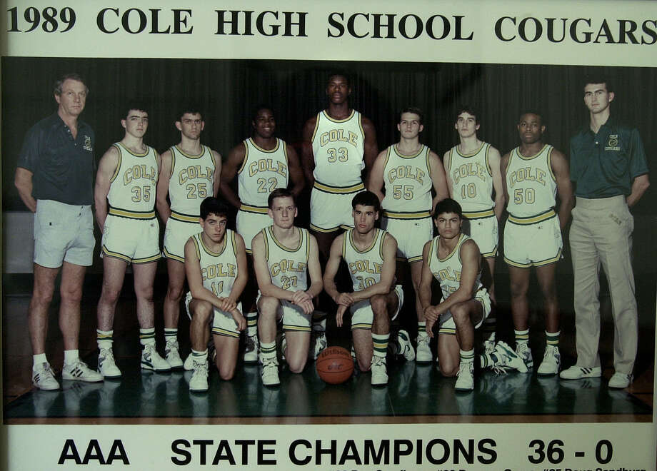 Photo of the 1989 Cole High School basketball squad where NBA star Shaquille O'Neal played. On the far right is current head coach Herb More who then was given the task of defending O'Neal during practices. Photo: Kin Man Hui /San Antonio Express-News / SAN ANTONIO EXPRESS-NEWS