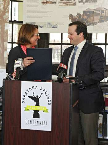 Mayor Joanne Yepsen accepts a proclamation from Sean Shortell, who was representing congressman Paul Tonko, as she and the City Centennial Committee Mark the 100th Anniversary of the April 7, 1915 Incorporation of the City of Saratoga Springs at the Saratoga Springs Visitors Center on Tuesday, April 7, 2015 in Saratoga Springs, N.Y.  (Lori Van Buren / Times Union) Photo: Lori Van Buren / 00031325A