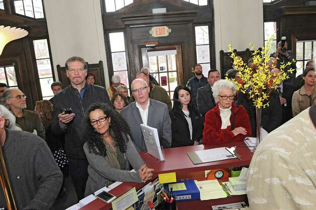 People listen to Saratoga Springs Mayor Joanne Yepsen and the City Centennial Committee Mark the 100th Anniversary of the April 7, 1915 Incorporation of the City of Saratoga Springs at the Saratoga Springs Visitors Center on Tuesday, April 7, 2015 in Saratoga Springs, N.Y.  (Lori Van Buren / Times Union) Photo: Lori Van Buren / 00031325A