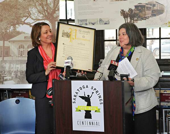Mayor Joanne Yepsen accepts a proclamation from Assemblymember Carrie Woerner as she and the City Centennial Committee Mark the 100th Anniversary of the April 7, 1915 Incorporation of the City of Saratoga Springs at the Saratoga Springs Visitors Center on Tuesday, April 7, 2015 in Saratoga Springs, N.Y.  (Lori Van Buren / Times Union) Photo: Lori Van Buren / 00031325A