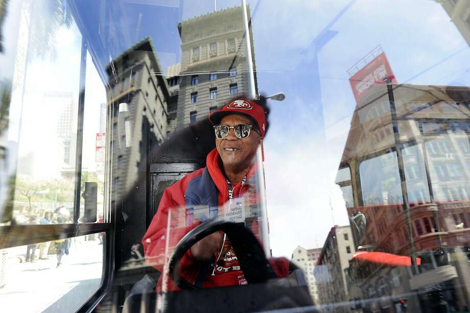 Edward Juniel of Deluxe Sightseeing says he is happy that a law is being passed barring drivers of tour busses from narrating their own tours while driving, at Union Square in San Francisco, CA, on Tuesday, April 7, 2015. Photo: Michael Short, Special To The Chronicle