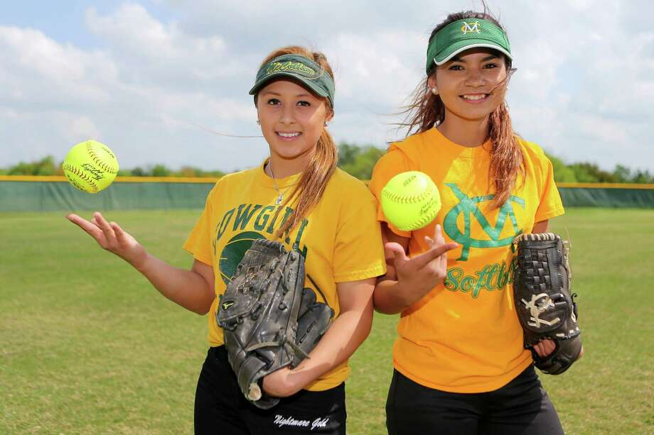 McCollum pitchers Kimberly Abundis (left) and Amber Saucedo prior to a practice session at the school. Photo: Marvin Pfeiffer /San Antonio Express-News / Express-News 2015