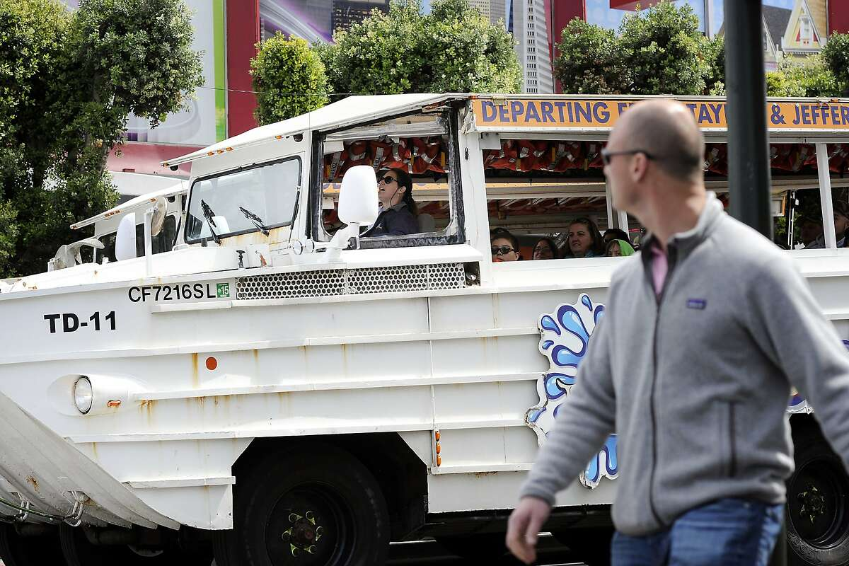 """A driver who gave the her company name as """"Anita Latte"""", wears a headset as she prepares to drive a Ride the Ducks tour bus leaving from Fisherman's Wharf in San Francisco, CA, on Tuesday, April 7, 2015. Ride the Ducks tour bus drivers still narrate their own tours."""