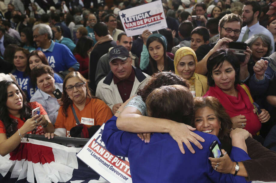 Low Texas turnout in November among Latinos likely was a factor in the losses by statewide candidate, including state Sen. Leticia Van de Putte, D-San Antonio, who was running for lieutenant governor. Here, she is embraced by Cynthia Esquivel, left, and Veronica Martinez, right, as she talks with supporters after announcing her run for that office at San Antonio College in 2013. Photo: Lisa Krantz /Associated Press / San Antonio Express-News