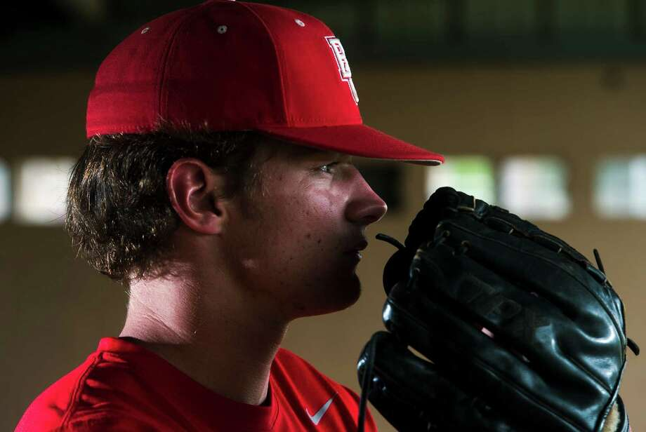 Chase Shugart poses for a portrait Wednesday afternoon. Shugart is a senior pitcher for Bridge City and will be going to the University of Texas. Photo taken Wednesday 4/1/15 Jake Daniels/The Enterprise Photo: Jake Daniels / ©2015 The Beaumont Enterprise/Jake Daniels