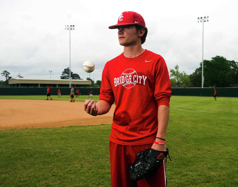 Chase Shugart poses for a portrait during practice Wednesday afternoon. Shugart is a senior pitcher for Bridge City and will be going to the University of Texas. Photo taken Wednesday 4/1/15 Jake Daniels/The Enterprise Photo: Jake Daniels / ©2015 The Beaumont Enterprise/Jake Daniels