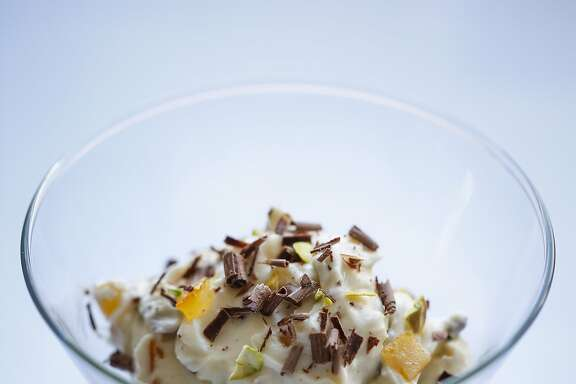 Whipped ricotta with candied orange, pistachios and chocolate is seen on Tuesday, April 7, 2015 in San Francisco, Calif.