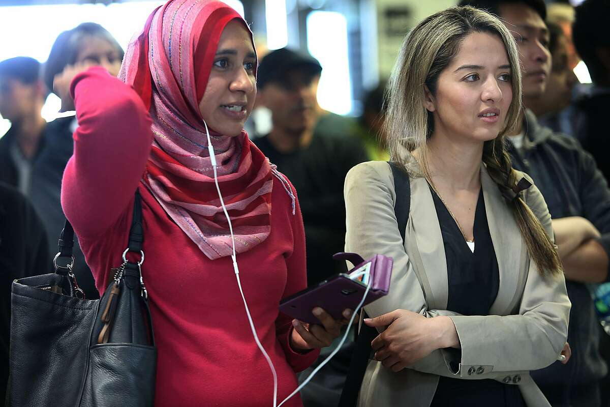 In this 2015 file photo, CAIR executive director Zahra Billoo (left) and attorney Nasrina Bargzie (right) wait for the arrival of Mokhtar Alkhanshali of Mocha Mill at SFO.
